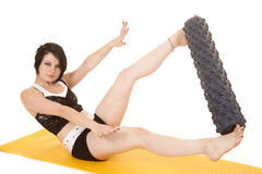 Woman fitness yellow mat roll between feet Stock Image