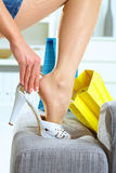 Woman fitting high heel shoes Royalty Free Stock Photo