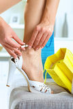 Woman fitting high heel shoes Royalty Free Stock Images