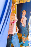 Woman in fitting-room. Spying upon the woman in a fitting-room of the clothes store Stock Photography