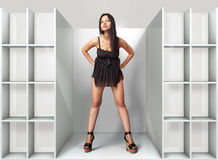 Woman in fitting-room l. Beautiful woman fits on a black dress in fitting-room Stock Photos