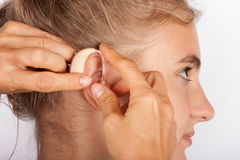 Woman fitting wiht hearing aid Stock Image