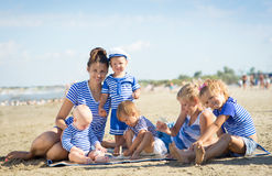 Woman with five children stock photos