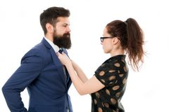 Woman fix her man bowtie. formal business couple. business with personal assistant. elegant woman fixing her lovers. Woman fix her men bowtie. formal business stock images