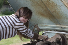 Woman Fixing Car Stock Image