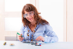 Woman fixing computer parts Royalty Free Stock Image