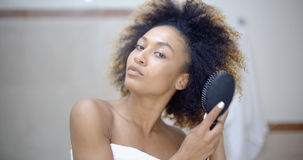 Woman Fixing Hair In The Morning Stock Images