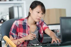 Woman fixing hard drive. Woman fixing a hard drive stock photos