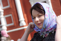 Woman fixing headscarf Royalty Free Stock Photos