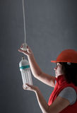 Woman fixing lamp Royalty Free Stock Photos