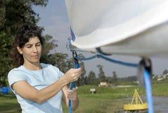 Woman Fixing Sail - Horizontal Royalty Free Stock Images