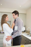 Woman fixing tie of husband before work Royalty Free Stock Image