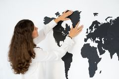 Couple is fixing the world map Royalty Free Stock Image