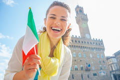 Woman with flag in front of palazzo vecchio, Italy Stock Images