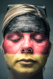Woman with flag of Germany on face and closed eyes Stock Images