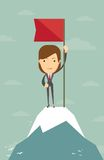 Woman with flag on a Mountain peak. Business success concept Royalty Free Stock Photo