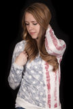 Woman flag shirt look down hand hair Stock Image