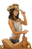 Woman in flag tank top cowgirl hat by saddle Royalty Free Stock Photos
