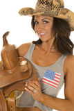 Woman in flag tank top cowgirl hold saddle look Royalty Free Stock Photos