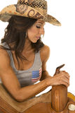 Woman in flag tank top cowgirl side lean on saddle Royalty Free Stock Image