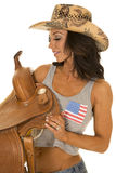 Woman in flag tank top hold saddle side Stock Images