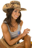 Woman in flag tank top lean on saddle smile Stock Image