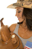 Woman in flag tank top side close cowgirl saddle Royalty Free Stock Photo