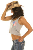 Woman in flag tank top side cowgirl hat on Royalty Free Stock Photography
