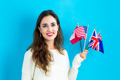 Woman with flags of English speaking countries Stock Photos