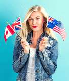 Woman with flags of English speaking countries Stock Image