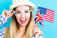 Woman with flags of English speaking countries Royalty Free Stock Photography