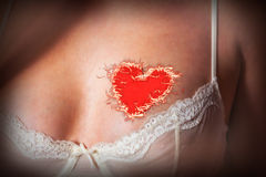 Woman with flaming heart tattooed Royalty Free Stock Images