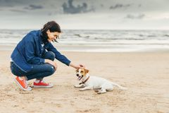 Woman flatters dog. Royalty Free Stock Images