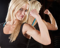 Woman flex mirror Stock Image