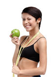 Woman with flexible ruler and green apple Stock Image