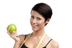 Woman with flexible ruler and healthy green apple Stock Photography