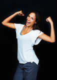 Woman flexing arms to display strength Royalty Free Stock Image