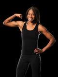 Woman Flexing Biceps Stock Image