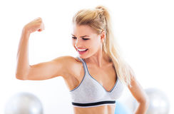 Woman flexing biceps Stock Photo