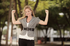 Woman flexing her arms Stock Photography