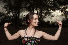 Woman flexing her arms Royalty Free Stock Photography