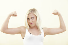 Woman flexing her biceps Stock Photography