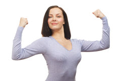 Woman flexing her biceps Royalty Free Stock Images