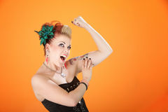 Woman flexing her muscle Royalty Free Stock Photography