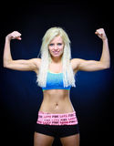 Woman flexing muscles Stock Image