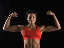 Woman flexing muscles. Royalty Free Stock Image