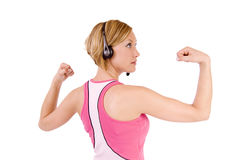 Woman flexing muscles Royalty Free Stock Image