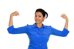 Woman flexing muscles Stock Photography
