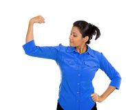 Woman flexing muscles Stock Images