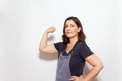 Woman flexing muscles hand hip Royalty Free Stock Image